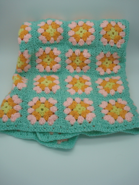 Hand-crotcheted cot blanket